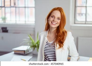 Sexy redhead secretary on desk