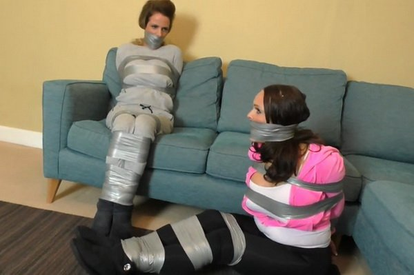 Beautiful woman in peril bound and gagged