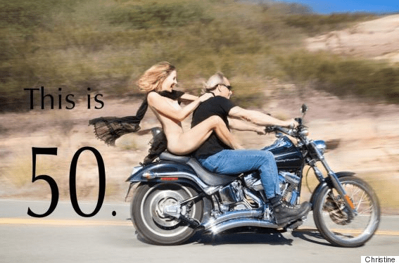 Woman riding motorcycle nude