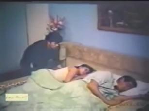 Wife fucks while husband sleeps