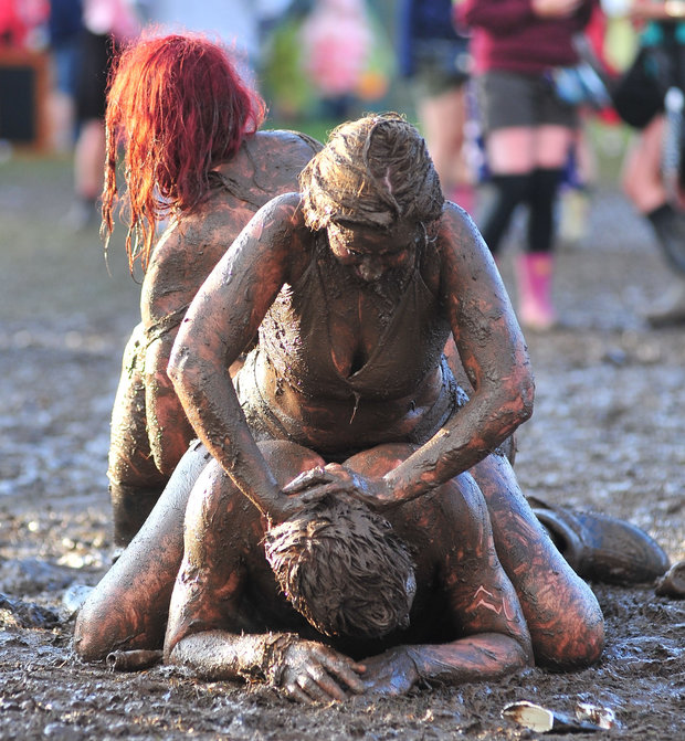 Naked nude mud wrestling