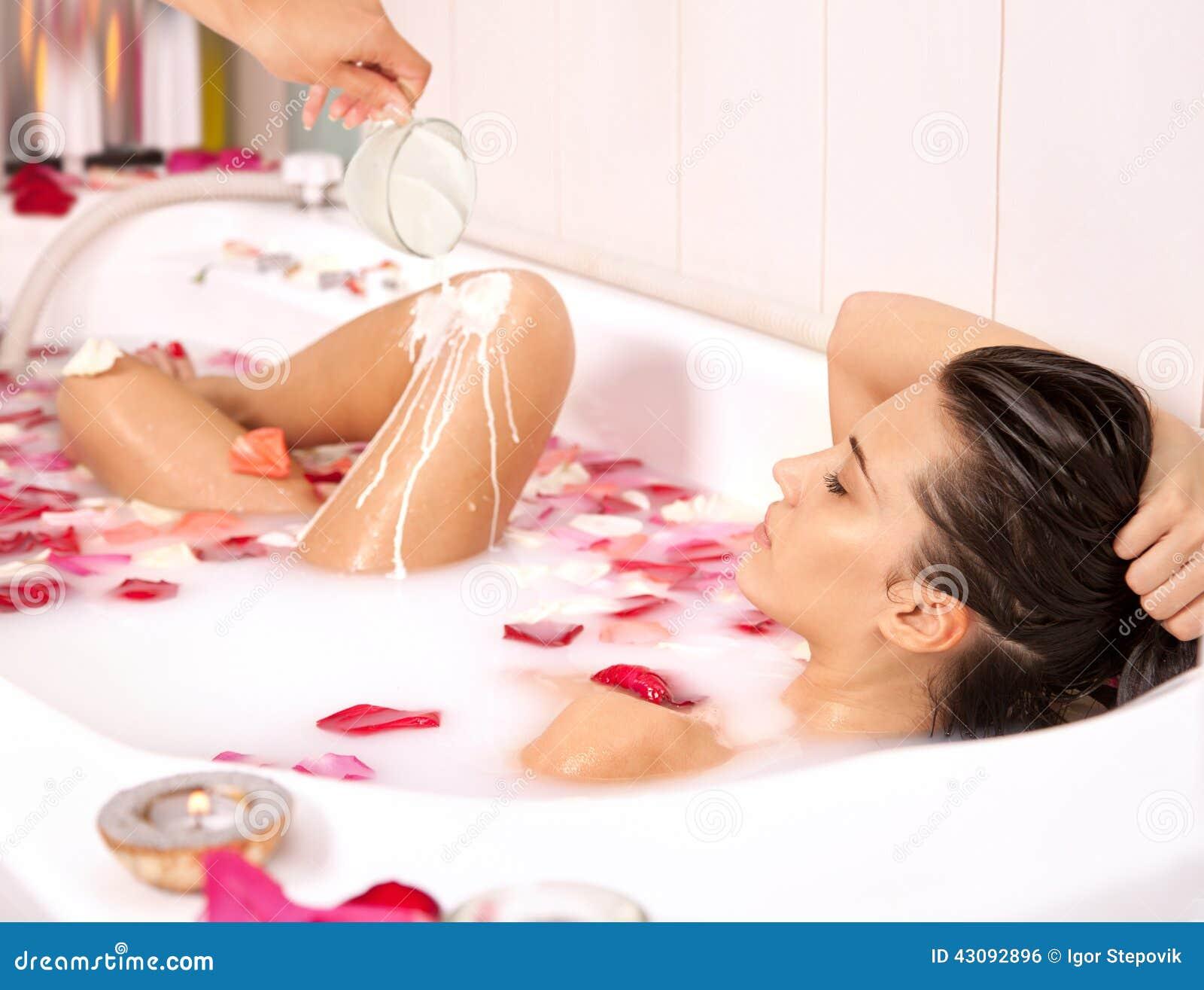 Nude girl in milk bath