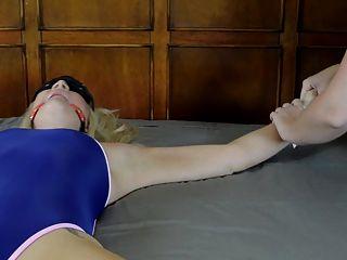 Woman bikini tied spreadeagled