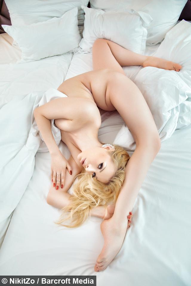 Flexible nude girl bent over