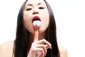 Asian girl eatin nut