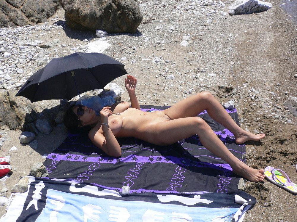 Nude sunbathing beach pussy