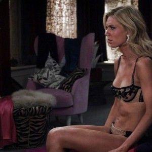 Half naked woman in bedroom