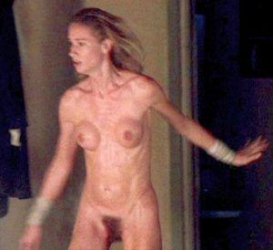 Woman pumping gas naked