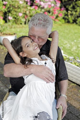 Very young girl and grandpa