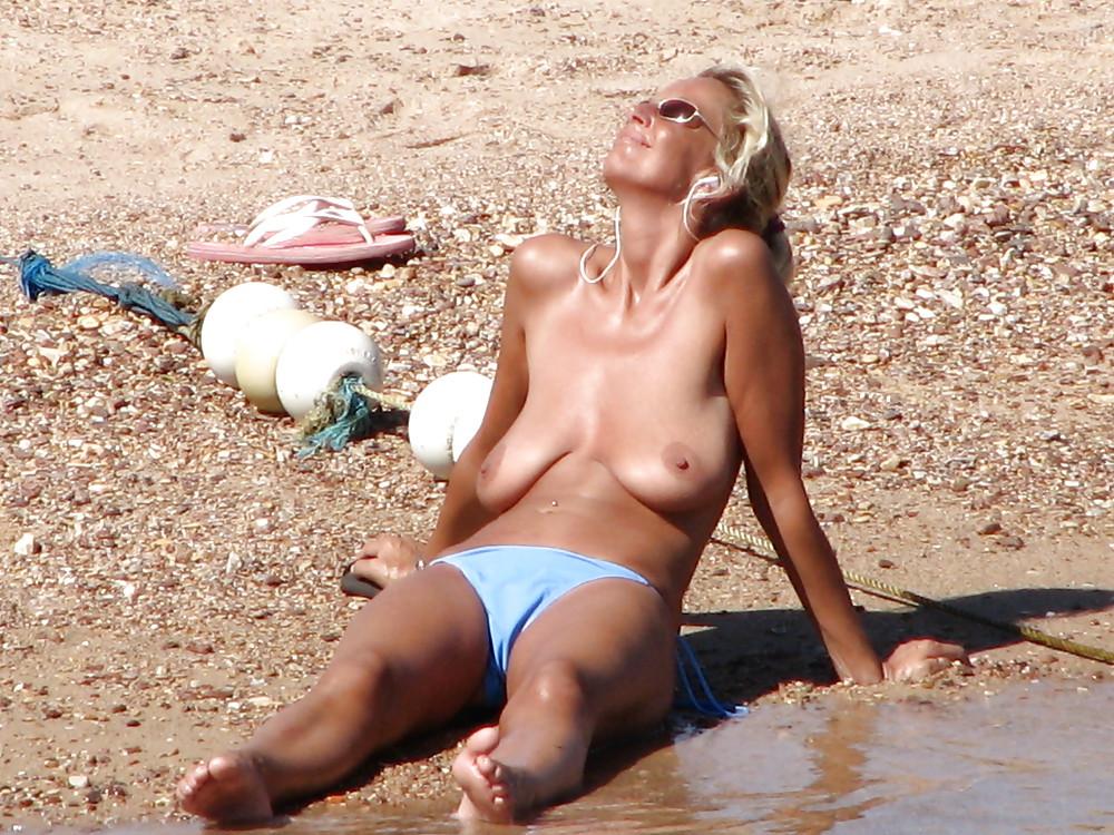 Mature saggy tits at beach