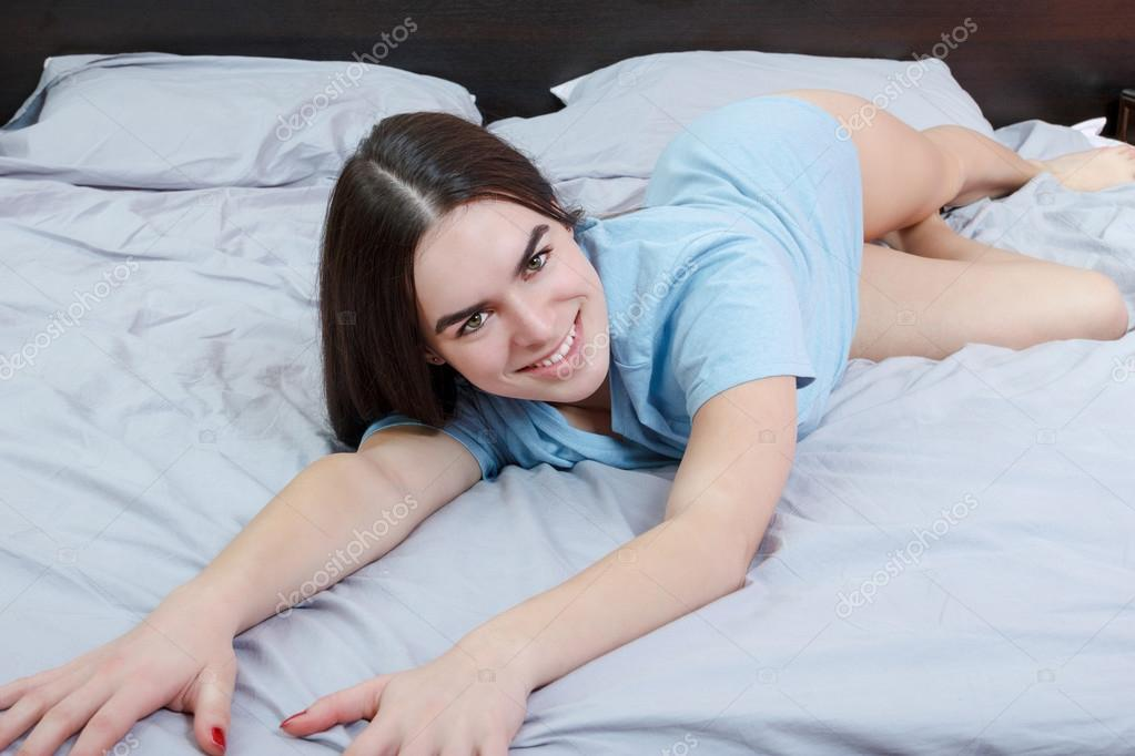 Half naked woman in bedroom
