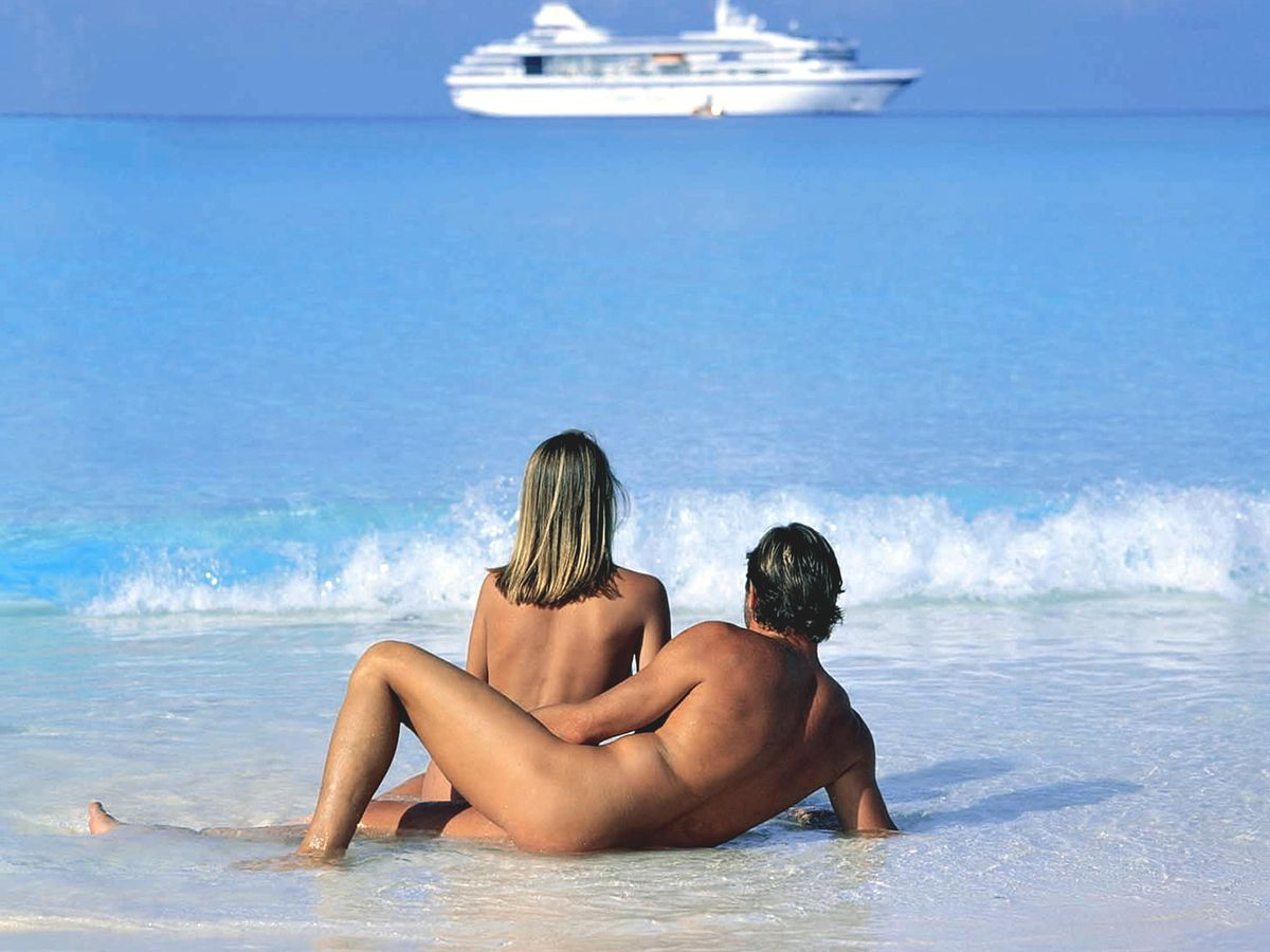 Playing at nude beach couples