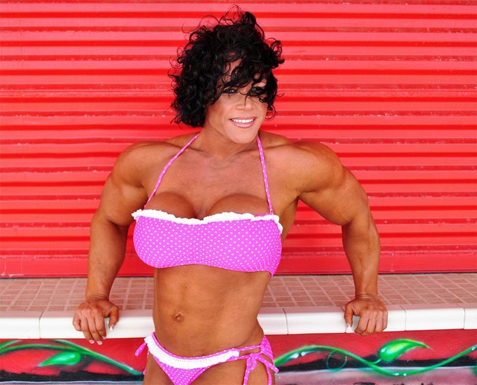 Truly huge bodybuilder flexing her muscles