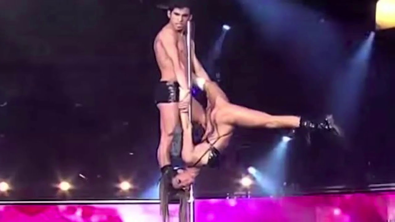 Naked pole dancers close up