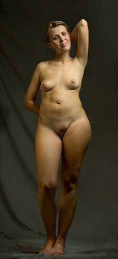 Curvy naked girl standing