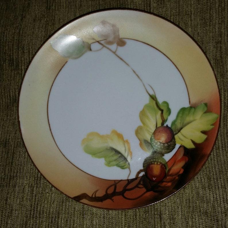 Antique porcelain green acorn wreath bottom