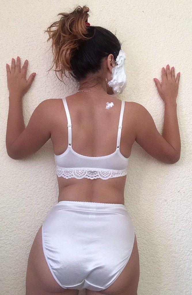 Girl in white satin panty