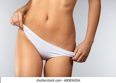 Real girls pulling down panties