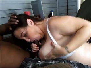 Busty brunette amateur sucking cock