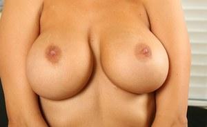 Girls feeling each others breast