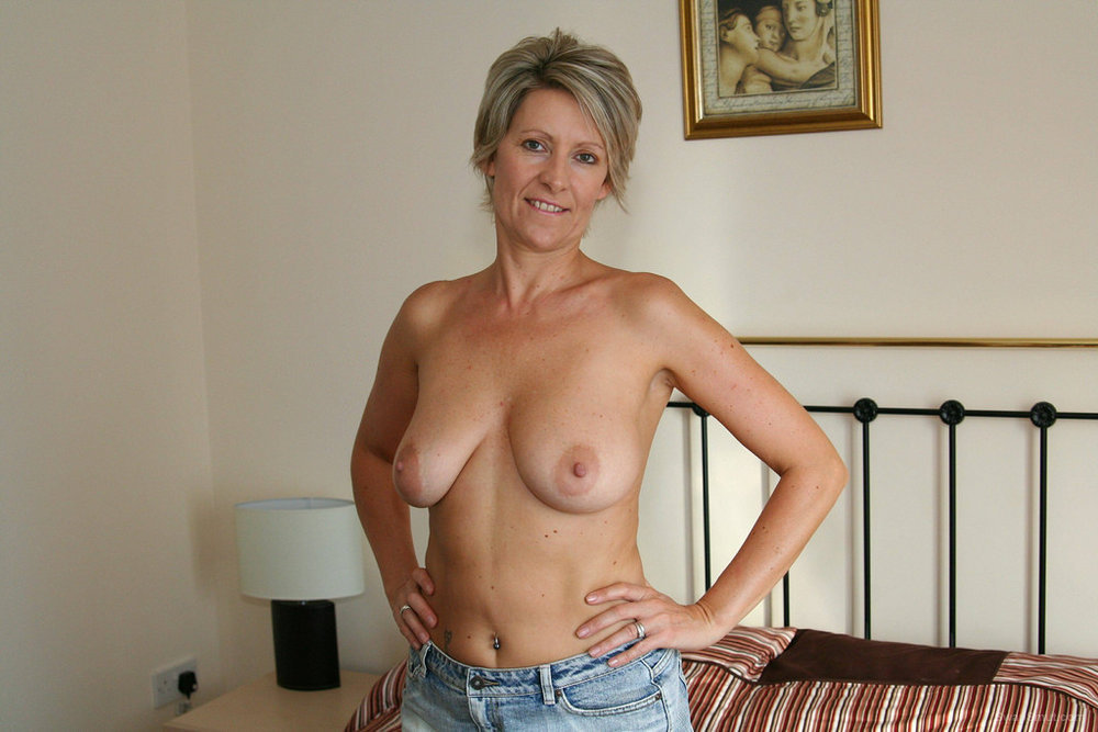 Mature wife showing big tits