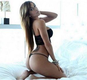 Nude brunette bent over