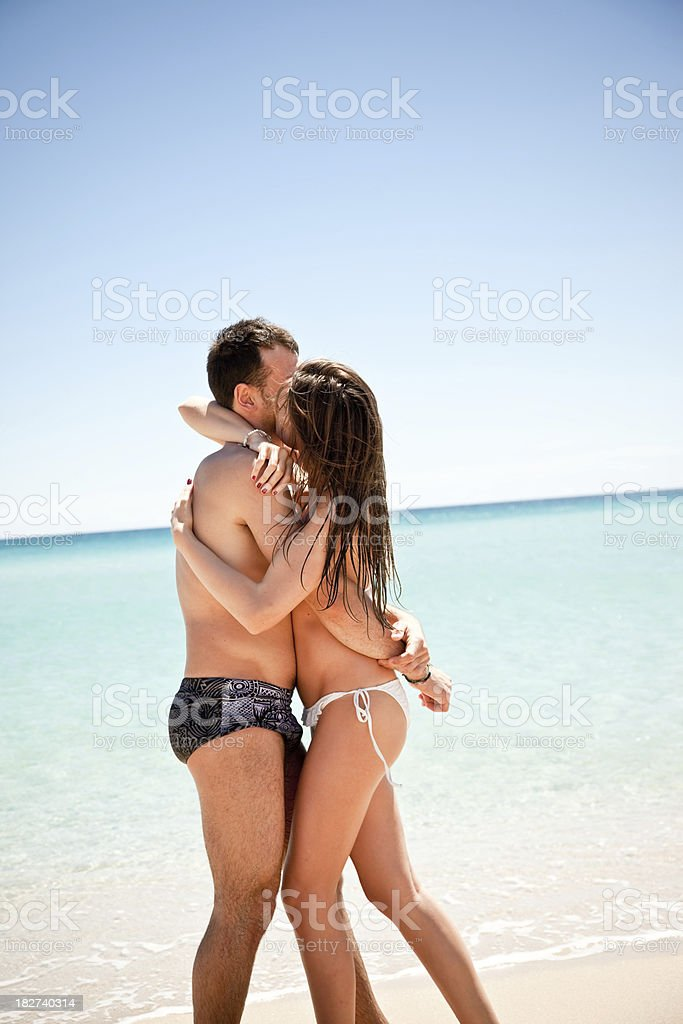 Naked couple on the beach nude