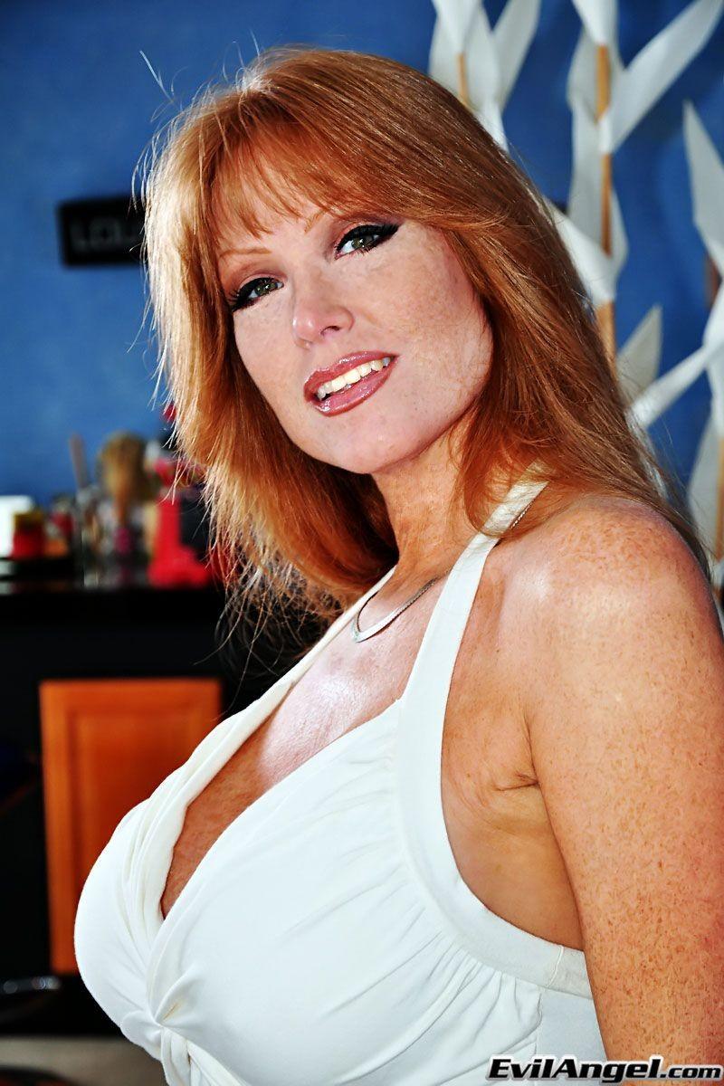 Redhead natural tits tan lines